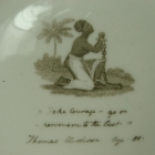 In an effort to persuade British consumers not to buy West Indian sugar, English ceramic manufacturers responded by making sugar bowls and tea sets inscribed with anti-slavery slogans. The kneeling image and motto 'Am I Not a Man and a Brother' became the symbols of the anti-slavery movement. The image was created by Josiah Wedgwood who was an abolitionist and also ran a pottery company
