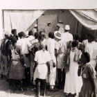 Official publicity shot for the Tanganyikan government. A crowd of people watch a public demonstration from health professionals. Tanganyika Territory (Tanzania), circa 1950