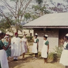 Sir Chief Joseph Odeleye Fadahunsi (b.1901), Governor of Western Nigeria from December 1962 to January 1966, is greeted by uniformed nurses on his visit to a Church of Nigeria hospital. Nigeria, November 1963