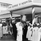 Nurses and hospital officials assemble outside the King George VI Hospital (now Kenyatta National Hospital), in preparation for a visit by the Duke of Edinburgh. Nairobi, Kenya, February 1952